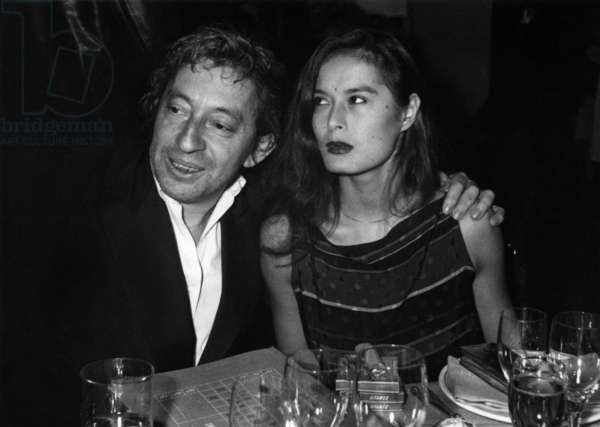 Serge Gainsbourg And His New Engage Bamboo Went To The Casino D'Enghien At The Gala Dinner Organize On The Occasion Of The Reestablishment Of The Games, October 13, 1981 - Serge Gainsbourg and New Girlfriend Bambou, at The Casino in Enghien, October 13, 1981 (b/w photo)