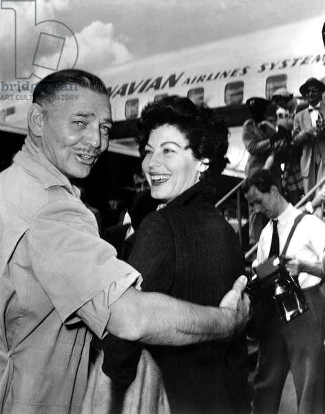 Clark Gable welcoming Ava Gardner as she arrives on location in Nairobi, Kenya for MOGAMBO, 1953