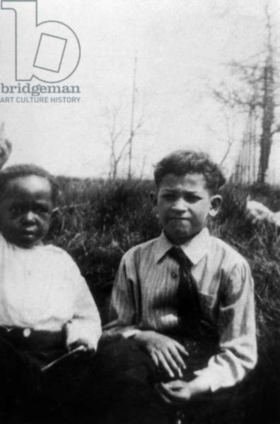 American saxophonist and jazz composer Charlie Parker (1920-1955) as a child c. 1922 (l)