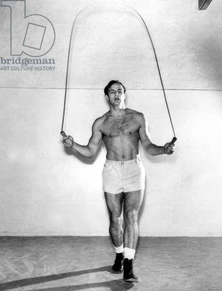 Marlon Brando jumping rope on June 30, 1954