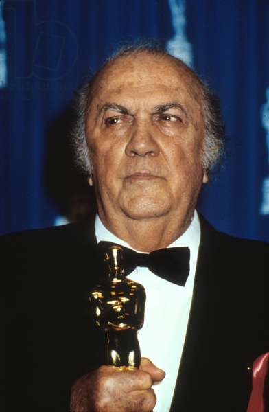 Italian director Federico Fellini with his Honorary Oscar at the 65th Oscar Ceremony in 1993
