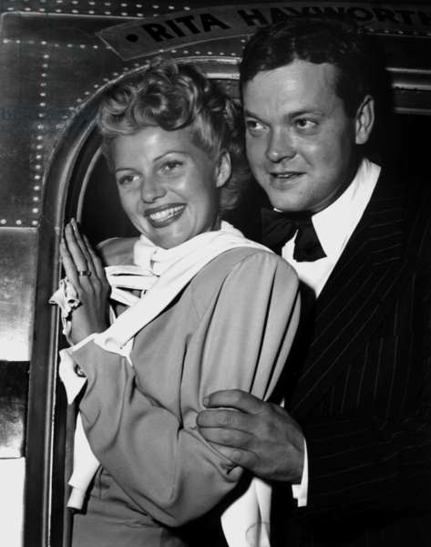 RITA HAYWORTH and husband ORSON WELLES board a special Lockheed flight to Mexico for location work on LADY FROM SHANGHAI, 1948