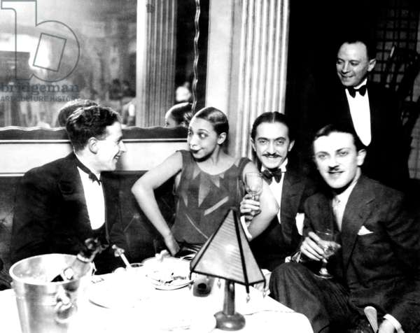 Josephine Baker with Georges Simenon (l) and her fiance Guiseppe Abatino called Pepito c. 1928 at restaurant Chez Josephine
