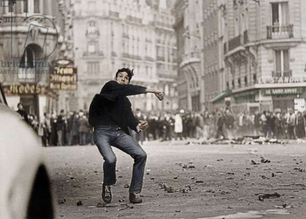 Student Throwing Cobblestones during Demonstration in Paris on May 25, 1968 (photo)