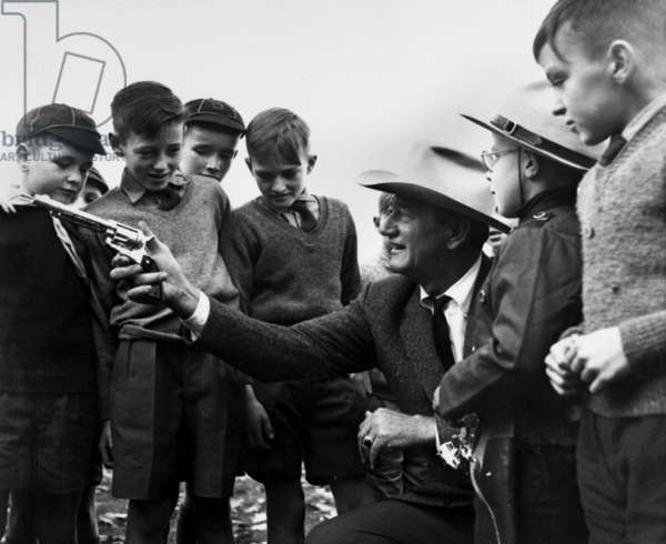 John Wayne showing his Colt Six Shooter to cub scouts in 1960