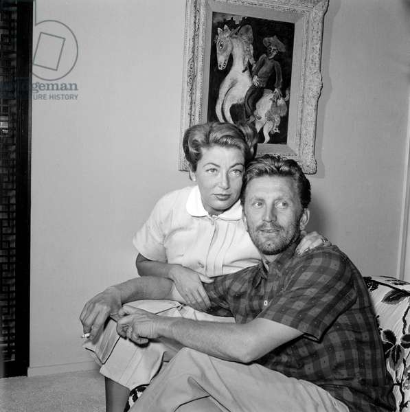 Actor Kirk Douglas with wife Anne at home c. 1954