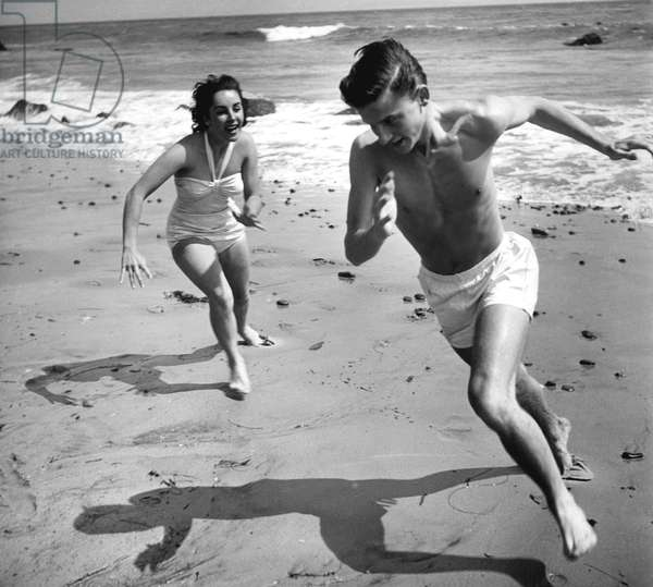 Elizabeth Liz Taylor and Roddy McDowall playing on the beach 1948