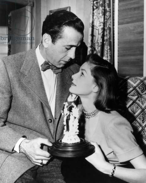 Humphrey Bogart, Lauren Bacall celebrate their first anniversary, May 1946