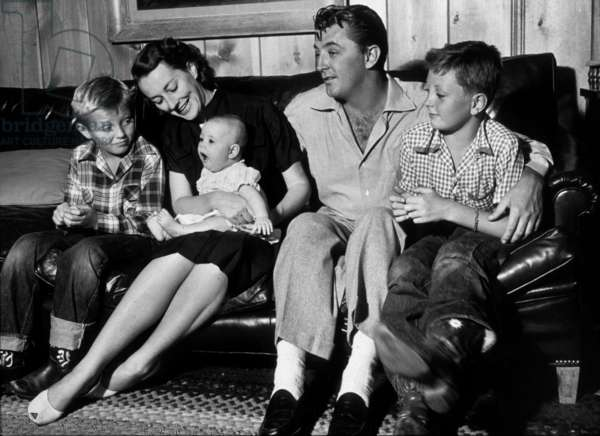 Robert Mitchum with his wife Doro and his children Jim and Chris in 1952