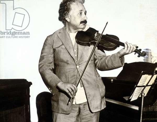 Albert Einstein (1879-1955), German physicist, here playing the violin c. 1932