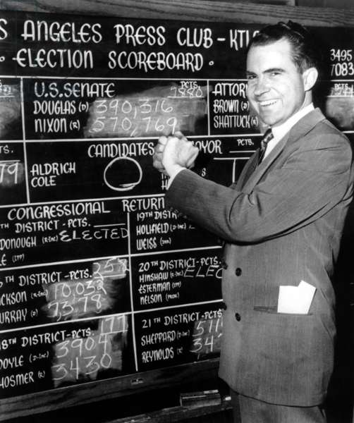 Richard Nixon in front of results blackboard announcing his victory at senatorial elections in California in 1950