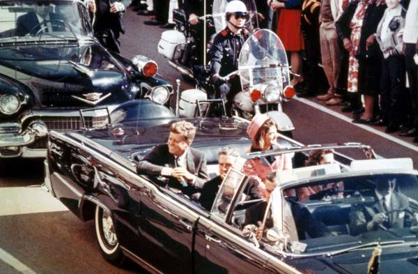 John F Kennedy and Jackie Kennedy (wearing strawberry-pink Chanel) suit in the Lincoln Continental where American President is going to be killed in Dallas on November 22, 1963, documentary WHERE WERE YOU ?