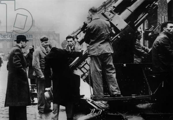 King George VI visits a weapons factory