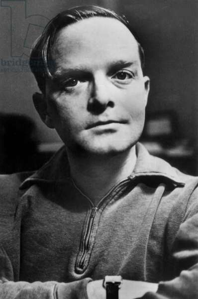 Truman Capote (1924-1984) American writer here c. 1960 (watch by Cartier)