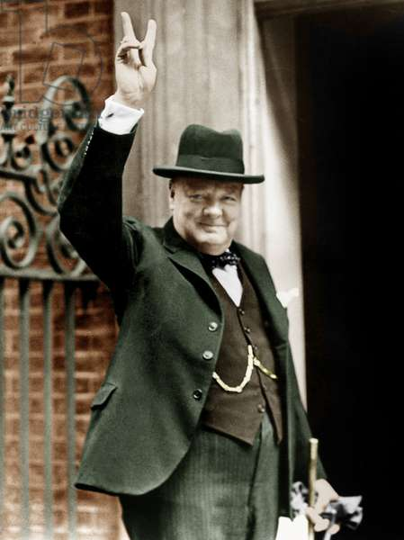 Winston Churchill, English Prime Minister, making the victory gesture in front of 10 Downing Street in June 1943, colourized document
