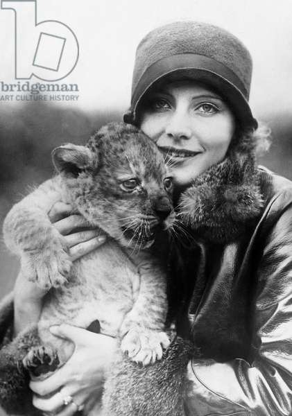 Young Swedish Actress Greta Garbo, real name Gustafsson (1905-1990) here holding a lion cub in her arms in 1925 near Los Angeles