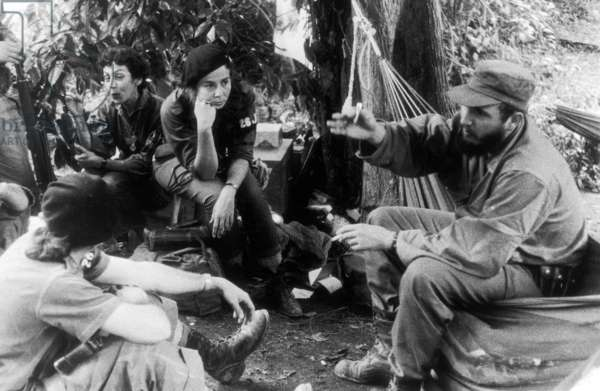 Fidel Castro with Celia Sanchez, his constant companion (far left), and Vilma Espin (left) Cuba, 1958 photograph by DickeyChapelle