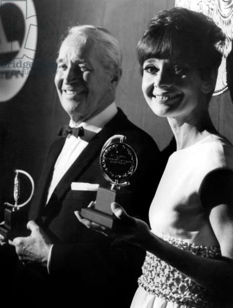 Maurice Chevalier and Audrey Hepburn receiving a Tony Award in 1957 for film Ariane
