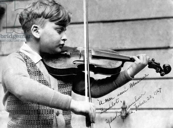 young violinist Yehudi Menuhin (b.1916) here in Paris February 23, 1927 . picture dedicated to Maurice Dandelot, future manager of the PleyelTheatre