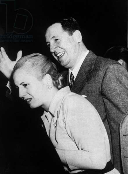 Juan Domingo Peron (1895-1974) former argentinian President and his wife Eva saluting crowd in Buenos Aires on October 29, 1948
