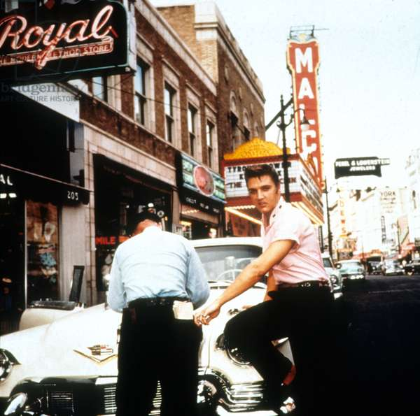 Elvis Presley getting verbalized by a policeman with his first Cadillac in 1956 in Nashville