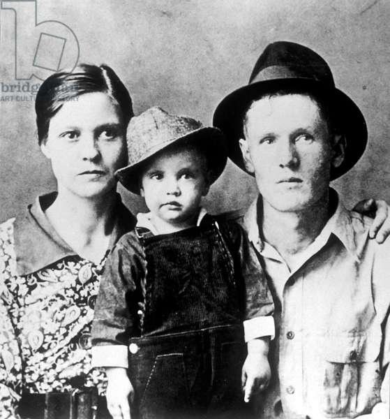 Elvis Presley as a child and his parents c. 1938