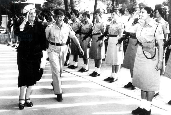 Israeli minister of foreign affairs Golda Meir reviewing women's military troops in Israel May 05, 1962