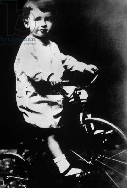 James Stewart (1908-1997) as a child, on bike, 1911