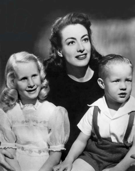 American Actress Joan Crawford with his 2 children Christine and Christopher 1946