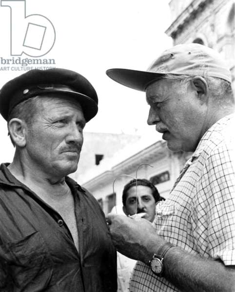 Ernest Hemingway (1899-1961) and Actor Spencer Tracy on set of film The Old Man and The Sea in 1958