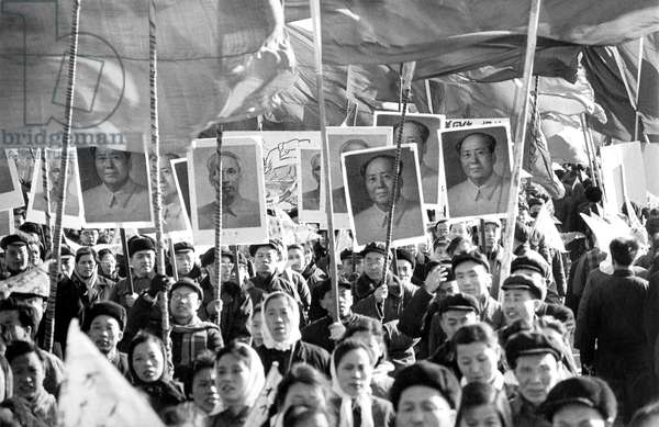 Communists demonstrators with flags and portraits to the glory of Mao Zedong at time Cultural Revolution in China in 1965 - 1968