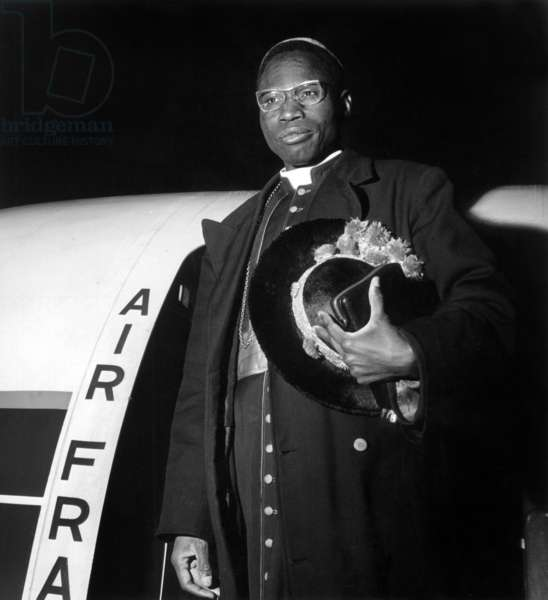 Neg: A8193PL Monsignor Zoungrana Archeveque d'Ouagadougou first African cardinal named Paul VI here before his departure aboard Air France's scheduled caravel to Frankfurt on March 9, 1965