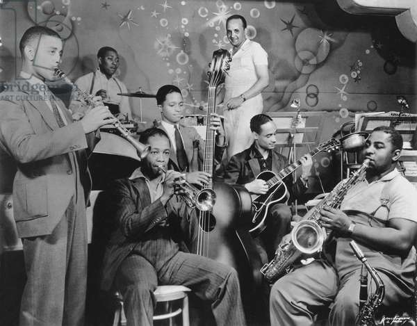 Fletcher Henderson (standing in c) with is orchestra c. 1935