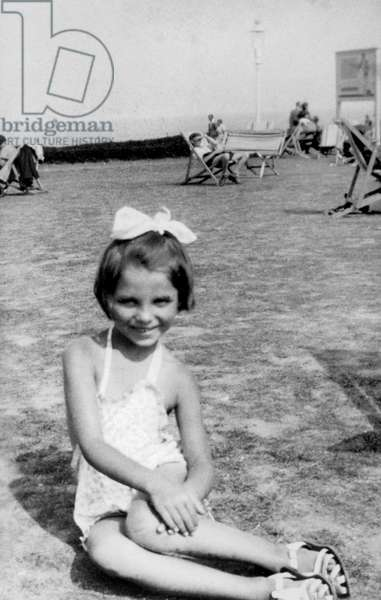 English Actress Joan Collins, born in 1933, as a child (5) on the beach, 1938