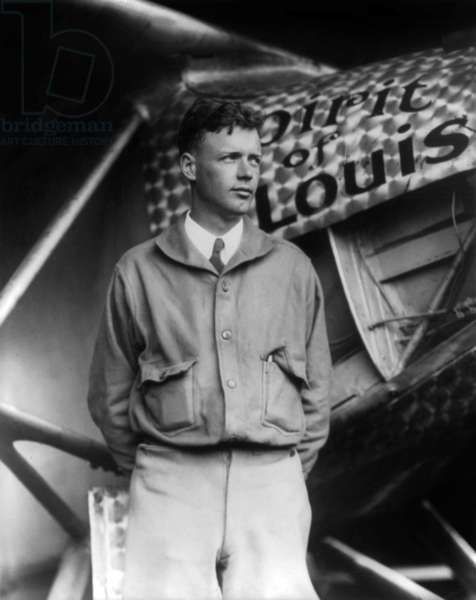 Charles Lindbergh (1902-1974) American pilot posing in front of his plane Spirit of St Louis before his crossing of Atlantic, May 14, 1927