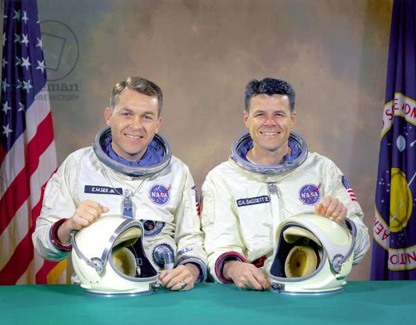 05/01/66 The original Gemini 9 prime crew, Astronauts Elliot M. See Jr. (left), command pilot, and Charles A. Bassett II, pilot, in space suits with their helmets on the table in front of them. On February 28, 1966 the prime crew for the Gemini 9 mission were killed when their twin seat T-38 trainer jet aircraft crashed into a building in which the Gemini spacecraft were being manufactured