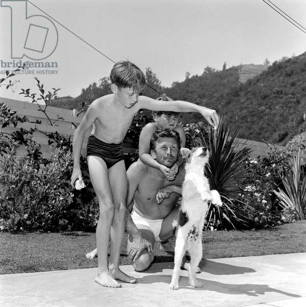Actor Kirk Douglas with sons Michael and Joel at home c. 1954