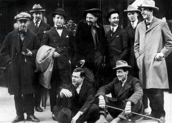 Outside Jockey Club, Paris, for oepning in November 1923. Seated : Tristan Tzara and Jean Cocteau ; standing l-r : Man Ray, Hilaire Hiler, Smith (Jockey), Ezra Pound, Les Copeland, Snow (owner), Curtis Moffat