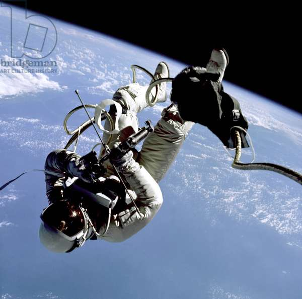 03/06/65 Edward H. White II, pilot of the Gemini 4 spacecraft, floats in the zero gravity of space with an earth limb backdrop