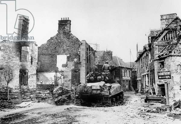 American tank entering in Domfront after the Normandy landings in France June 1944
