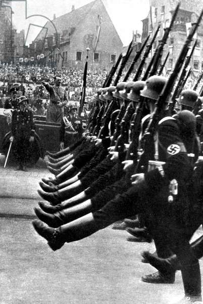 Adolf Hitler saluting the parade of the SS troops c; 1938