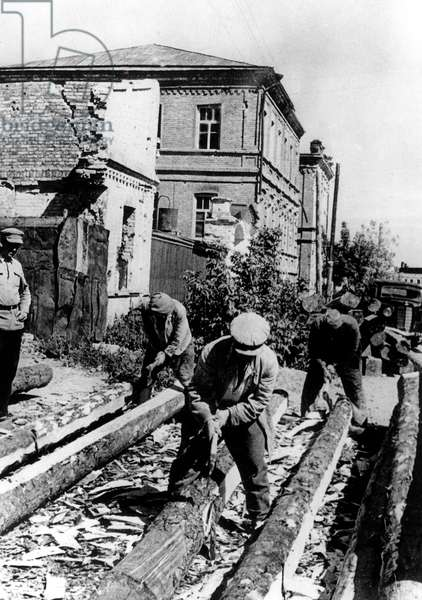 After battle of Stalingrad which ended in February 1943, workers building destroyed houses