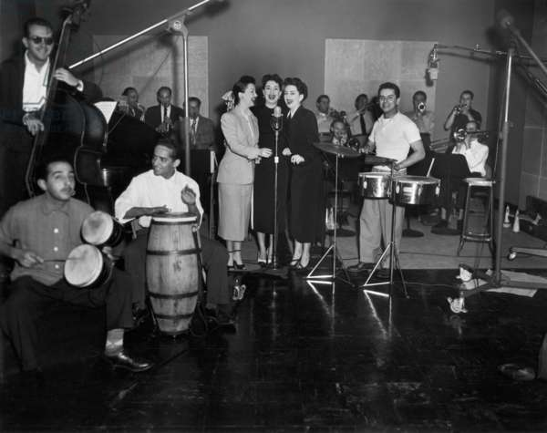 De Castro sisters and Tito Puente Orchestra with Tito Puente (r) at drums in New York c. 1955