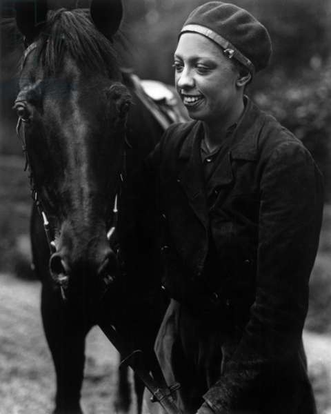 Josephine Baker with a horse, 1938