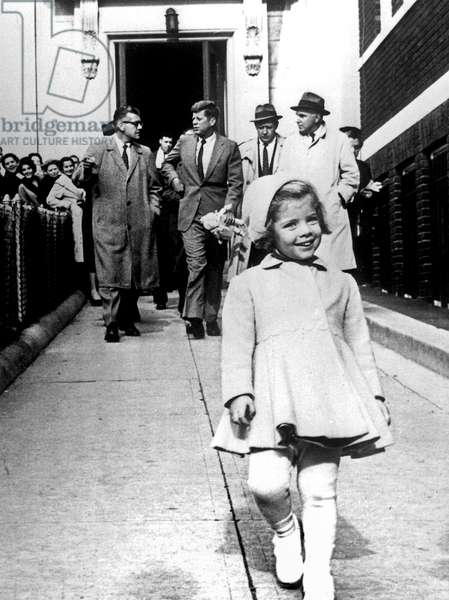 American President John Kennedy with his daughter Caroline walking ahead early 1961