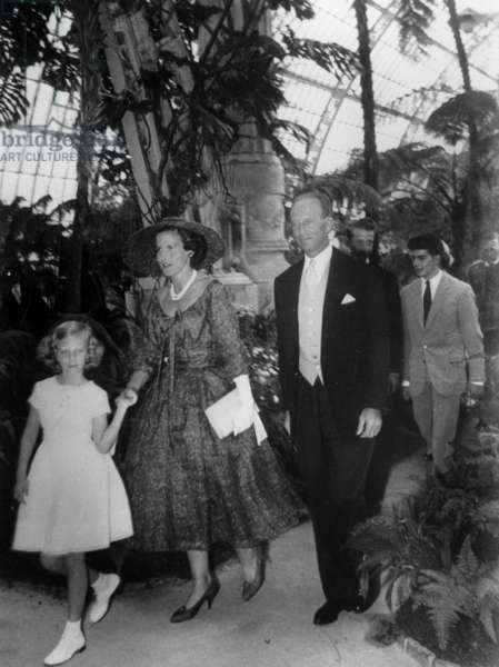 Princess Lilian of Rethy (born Mary Lilian Baels) and her husband former King  Leopold III of Belgium, with young Princess Marie-Christine of Belgium (l) and in the background young King  Baudoin 1st of Belgium and his brother Prince Albert of Belgium (future King  Albert II) during Garden Party in the greenhouse of Haeken castle in Brussels May 13, 1958. In the background : prince Alexander of Belgium