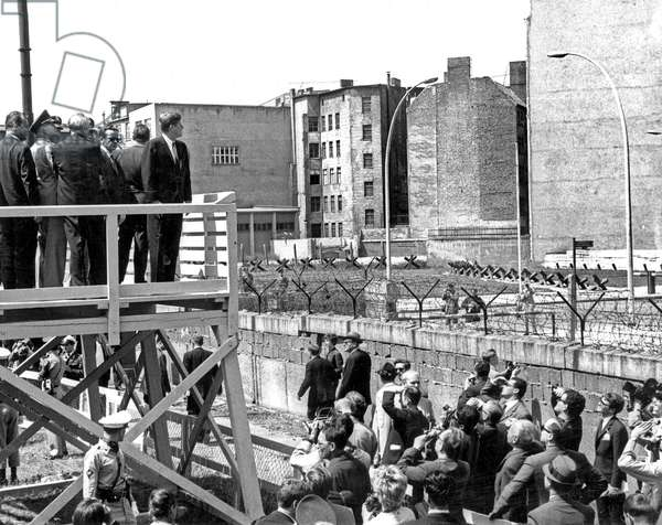 President John Kennedy and West German Chancellor, Konrad Adenauer, looking over the Berlin Wall into East Berlin. June 26, 1963