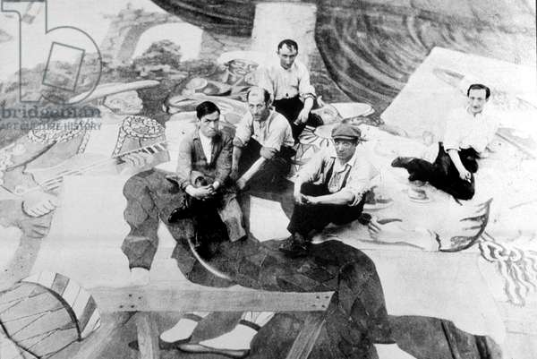 Spanish Painter Pablo Picasso sitting on the curtain of the 'Ballet Parade', 1917 (b/w photo)