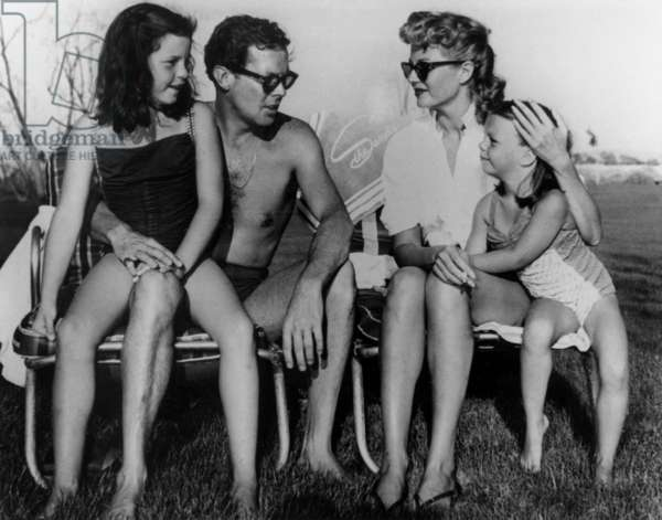 Actress Rita Hayworth and 4th husband Dick Haymes with her daughters Rebecca Welles and Yasmine Khan, October 1953
