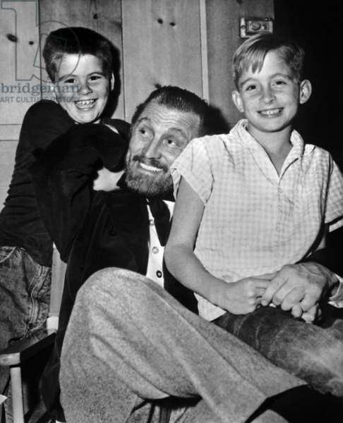 Actor Kirk Douglas with his sons Joel (l) and Michael on set of film in 1955